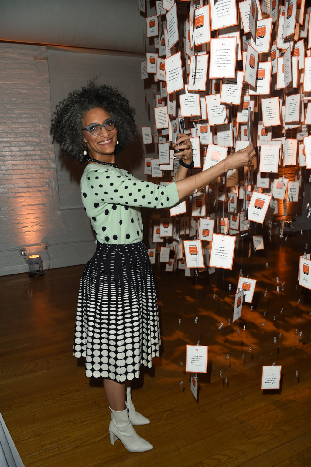 Chef Carla Hall adds her quote of empowerment to the installation.