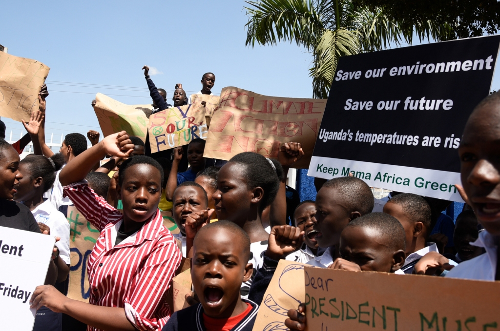KAMPALA, UGANDA: Students hold placards during a strike as part of a global day of student protests aiming to spark world leaders into action on climate change at Najjanankumbi young christian school.