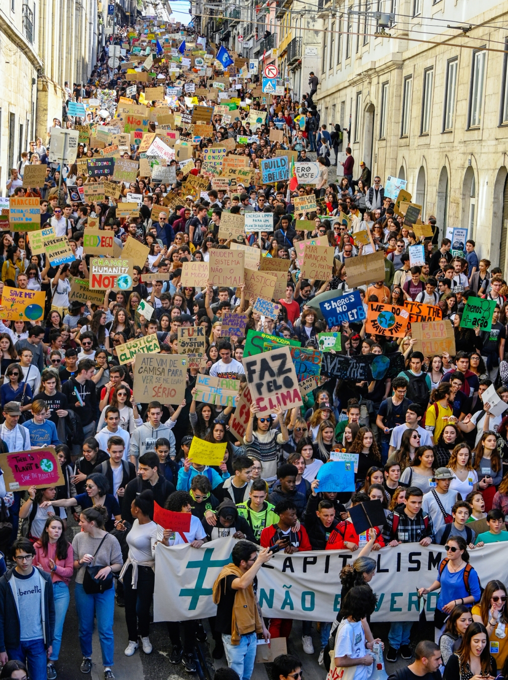 LISBON, PORTUGAL: Portuguese students chant and hoist placards in front of the Assembleia da Republica (Portuguese Parliament) during their demonstration to support actions for climate change.