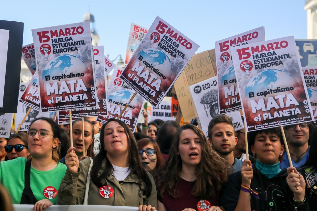 MADRID, SPAIN: Students carried posters condemning the impact of capitalism on the environment.