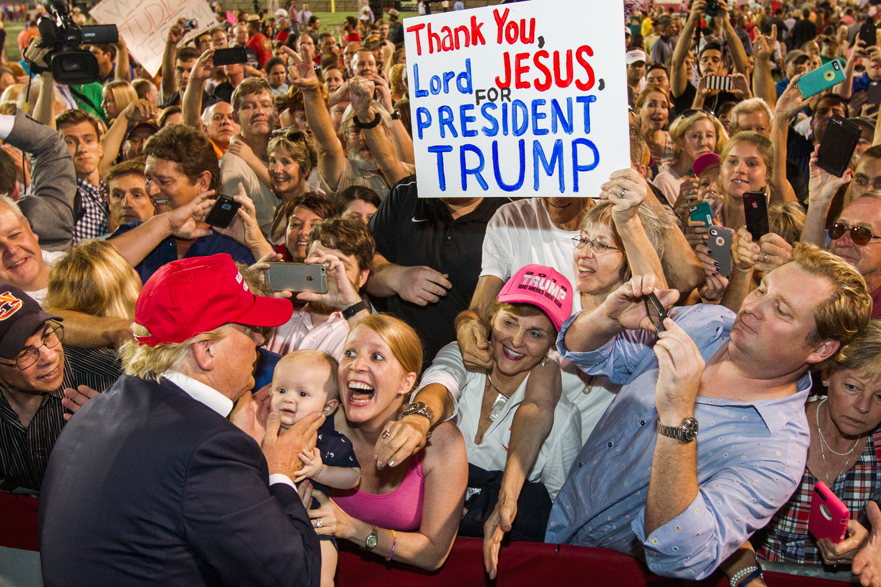 Republican presidential candidate Donald Trump greets supporters after his rally at Ladd-Peebles Stadium on August 21, 2015 in Mobile, Alabama. The Trump campaign moved tonight's rally to a larger stadium to accommodate demand.