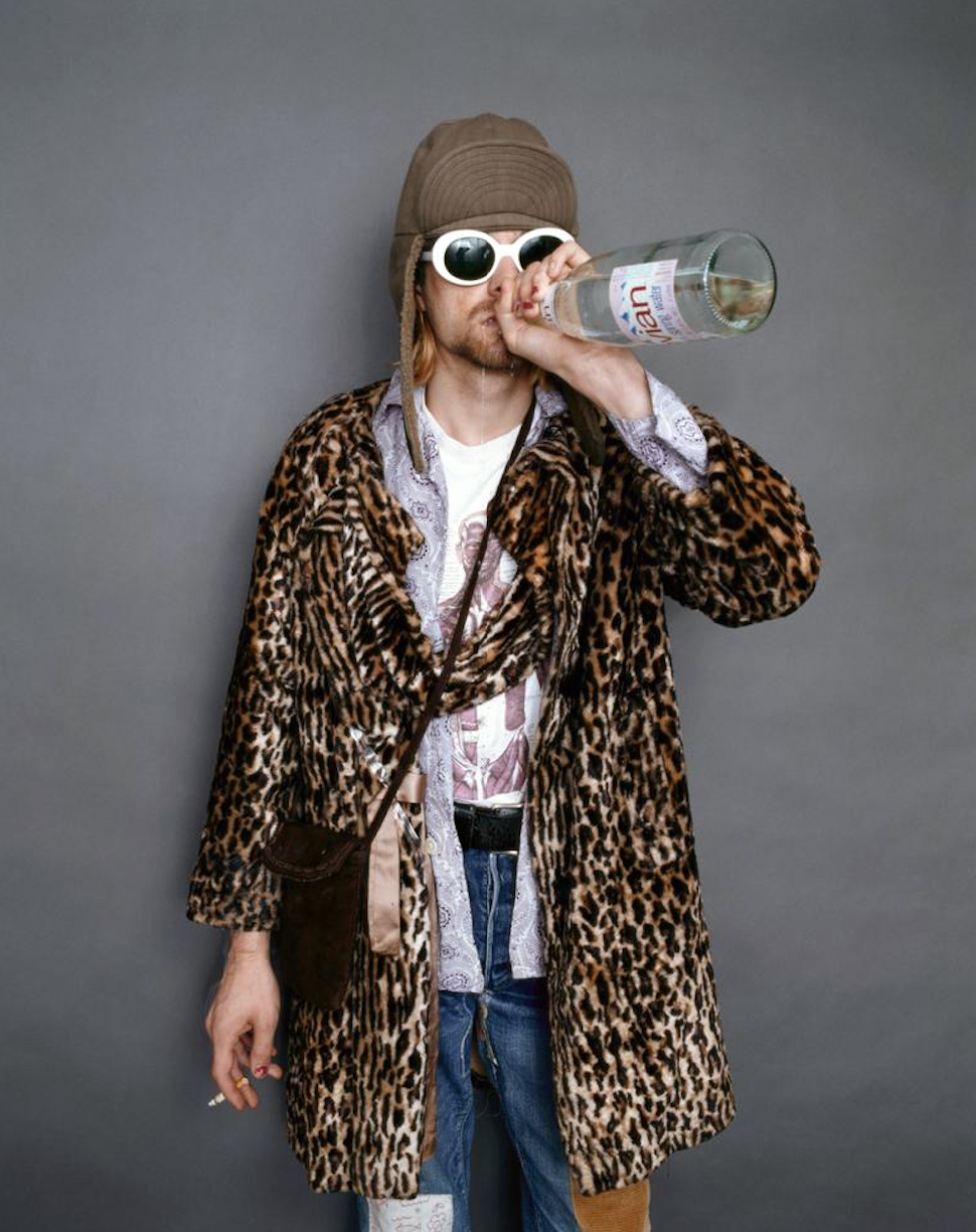 """Cobain drinking Evian at the Omni Hotel in New York in 1993. """"At some point he started spitting out the water,"""" recalls Frohman. """"He enjoyed having his picture taken while he was doing that. Like a little kid."""""""