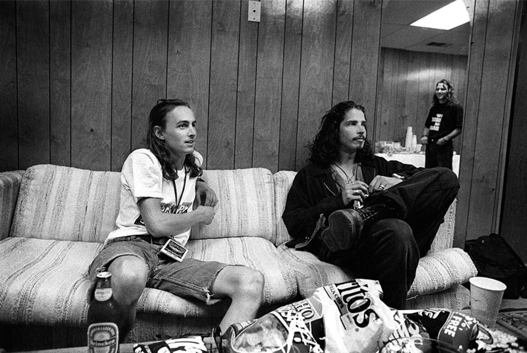 Pearl Jam guitarist Mike McCready and Soundgarden's Chris Cornell talking to Vedder backstage at Lollapalooza in 1992.