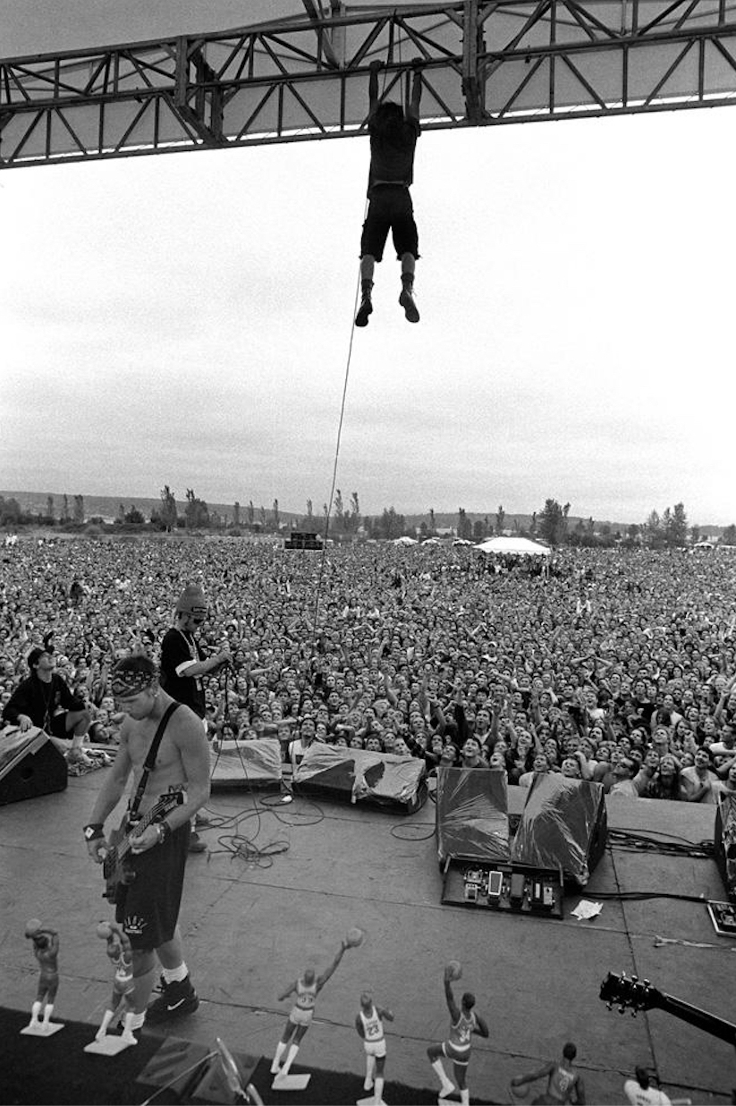 """Vedder became notorious for climbing and hanging off the stage during performances. """"That was actually a tame one compared to others,"""" Mercer recalls of their legendary Drop in the Park show in 1992. Mercer, who toured with Pearl Jam as their official photographer from 1991 through 1995, witnessed the band achieve massive success. """"That's the moment where I realized what a big deal it was, because so many people were there,"""" he says."""