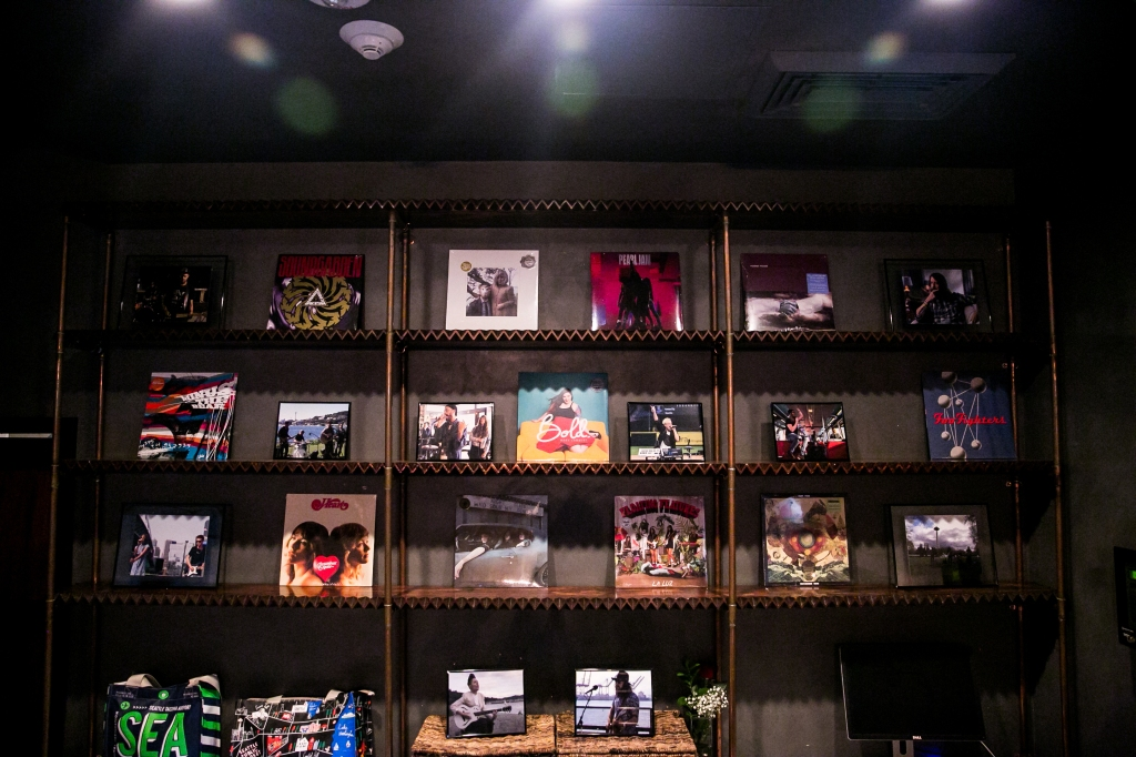 Albums by Seattle-based bands were displayed throughout Native Hostel