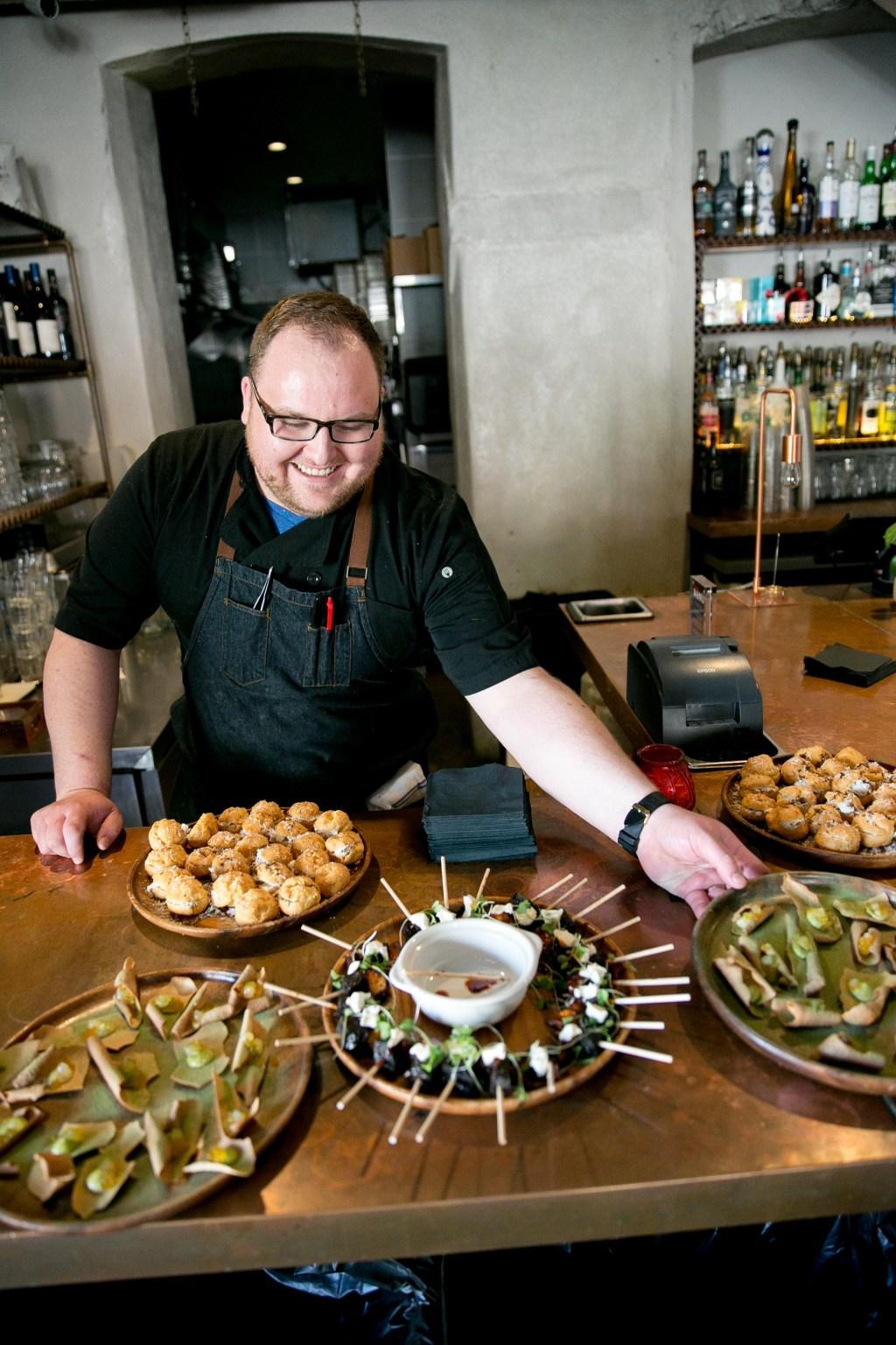 Chef Maximillian Petty, of Eden Hill, prepares local Seattle fare including crispy octopus, sea scallop madrone bark, Eden Hill foie gras cake batter with strawberries and more…