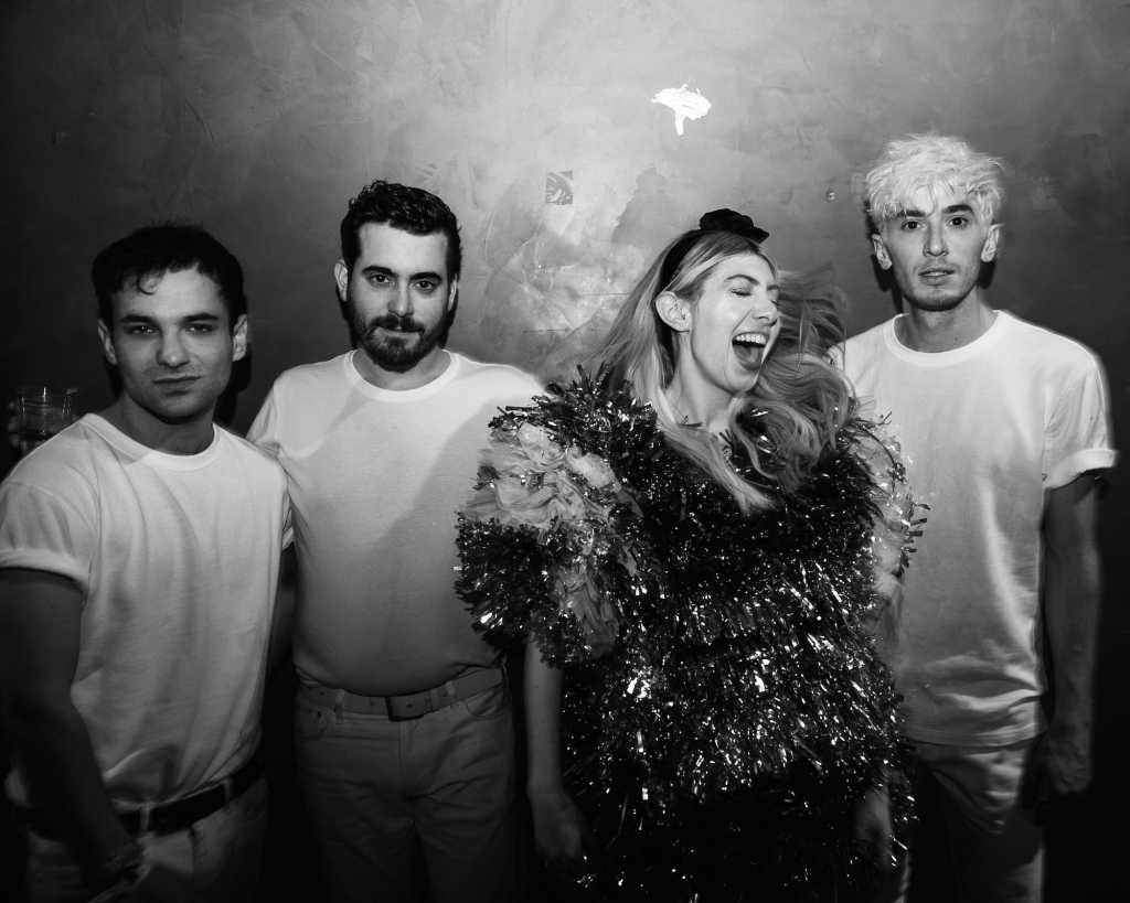 Charly Bliss stops to pose for a group shot