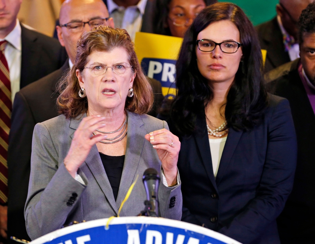 Kendra Hare, Allison Riggs Attorney's Kendra Hare, left, gestures as Allison Riggs, right, listens during a news conference at the Third Street Bethel AME Church in Richmond, Va., . The press conference was held to talk about the appeal before the 4th U.S. Circuit Court of Appeals on North Carolina's major rewrite of voting laws in 2013Voter ID Lawsuit, Richmond, USA