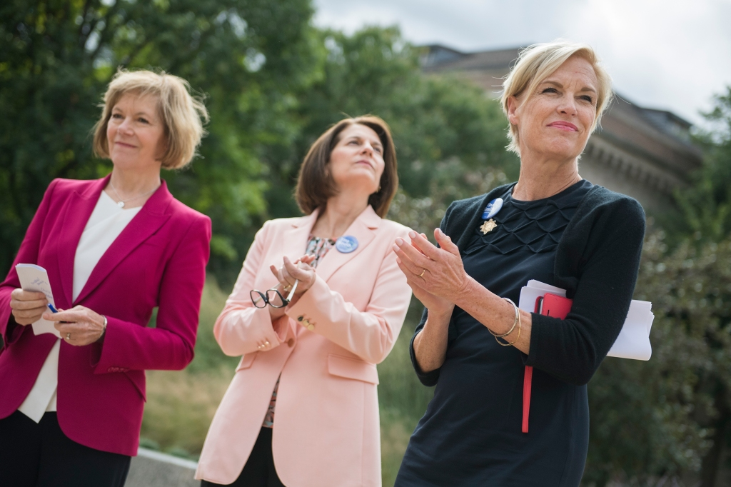 UNITED STATES - SEPTEMBER 21: From left, Sens. Tina Smith, D-Minn., Catherine Cortez Masto, D-Nev., and Cecile Richards, attend an early voting rally at the University of Minnesota in Minneapolis on September 21, 2018. (Photo By Tom Williams/CQ Roll Call)