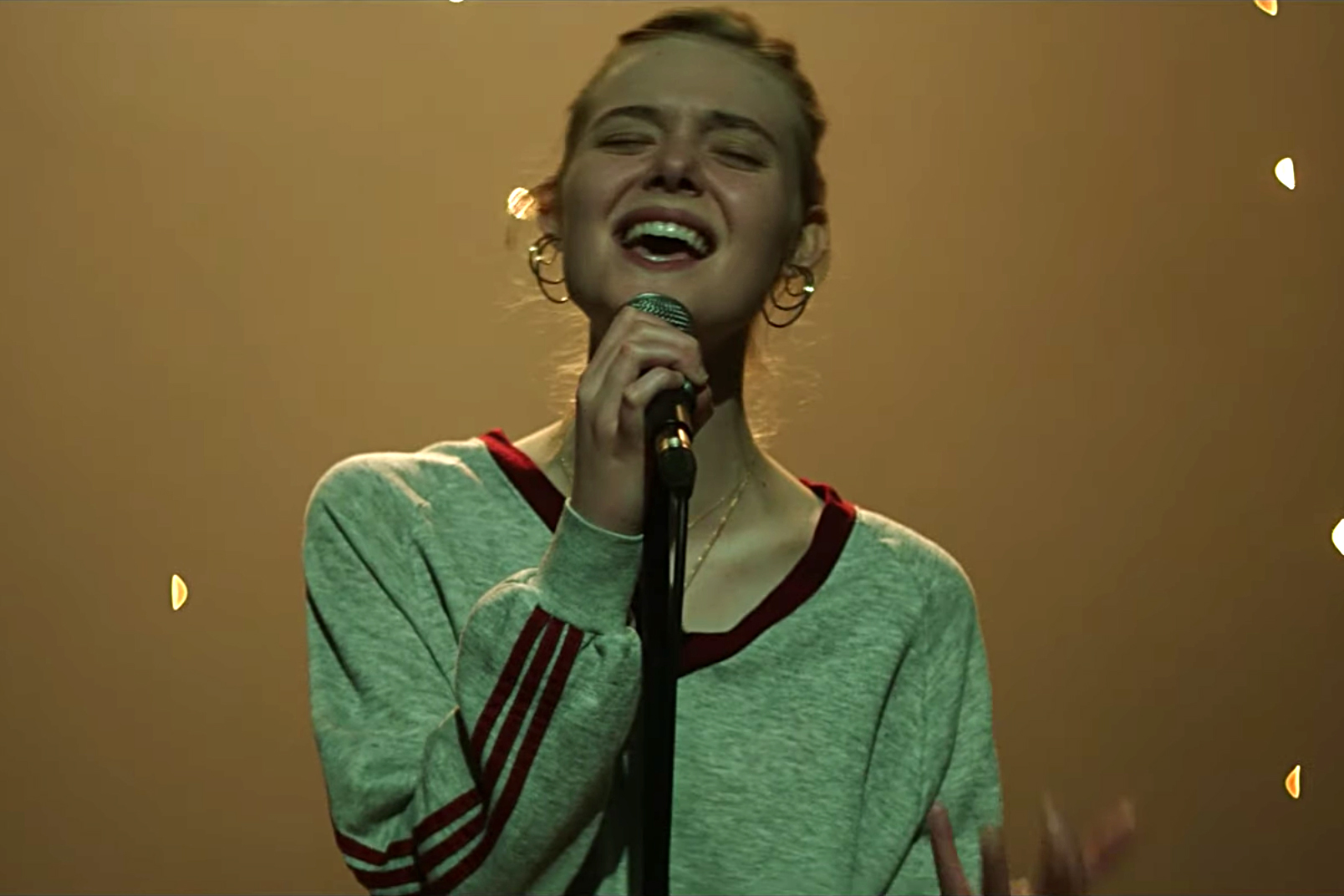 Watch Elle Fanning's Full Performance of Robyn's 'Dancing On My Own' in 'Teen Spirit' Clip
