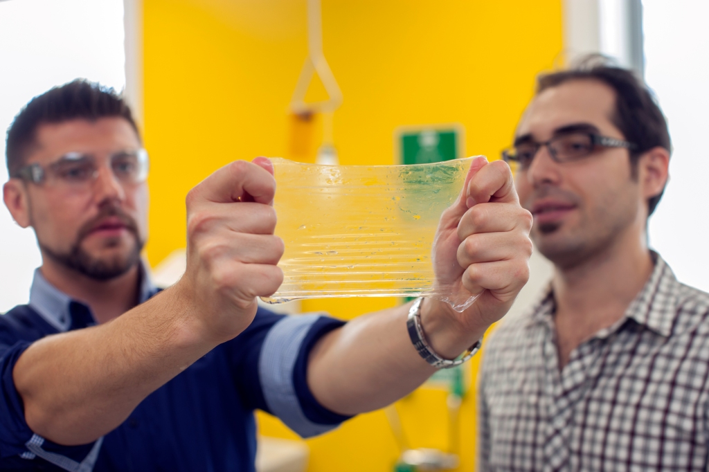 Dr. Robert Gorkin and an associate test their hydrogel material. Photo credit: Mark Newsham