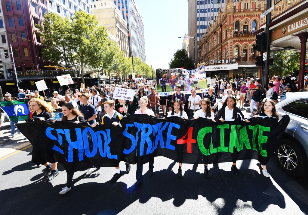ADELAIDE, AUSTRALIA: School students march up King William Street outside South Australia's Parliament House, during the global climate strike.