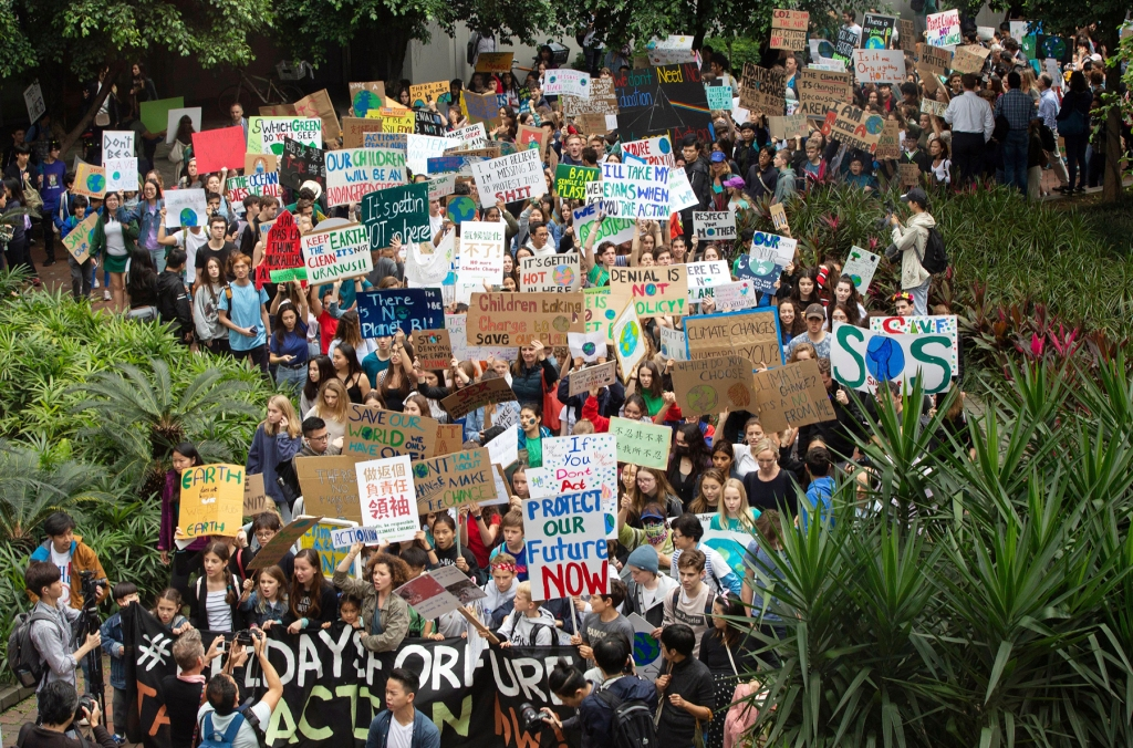 HONG KONG: Students march through the streets as they strike to protest climate change.