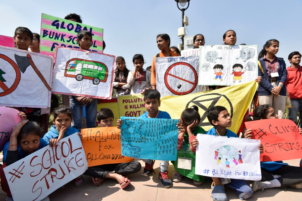 NEW DELHI, INDIA: Striking students hold placards and banners with the slogans #fridaysforfuture and #climatestrike and warning of the dangers of pollution.