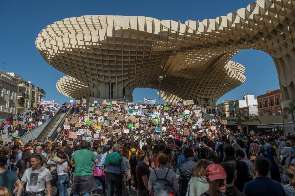 Spanish protestors gathered outside the Metropol Parasol in Seville, Spain.