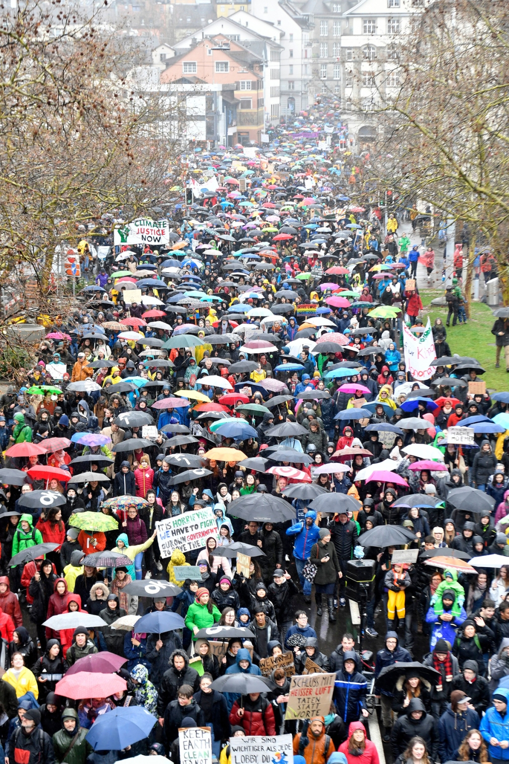 ZURICH, SWITZERLAND: The rain didn't stop thousands of protestors from taking to the streets in Zurich on Friday.