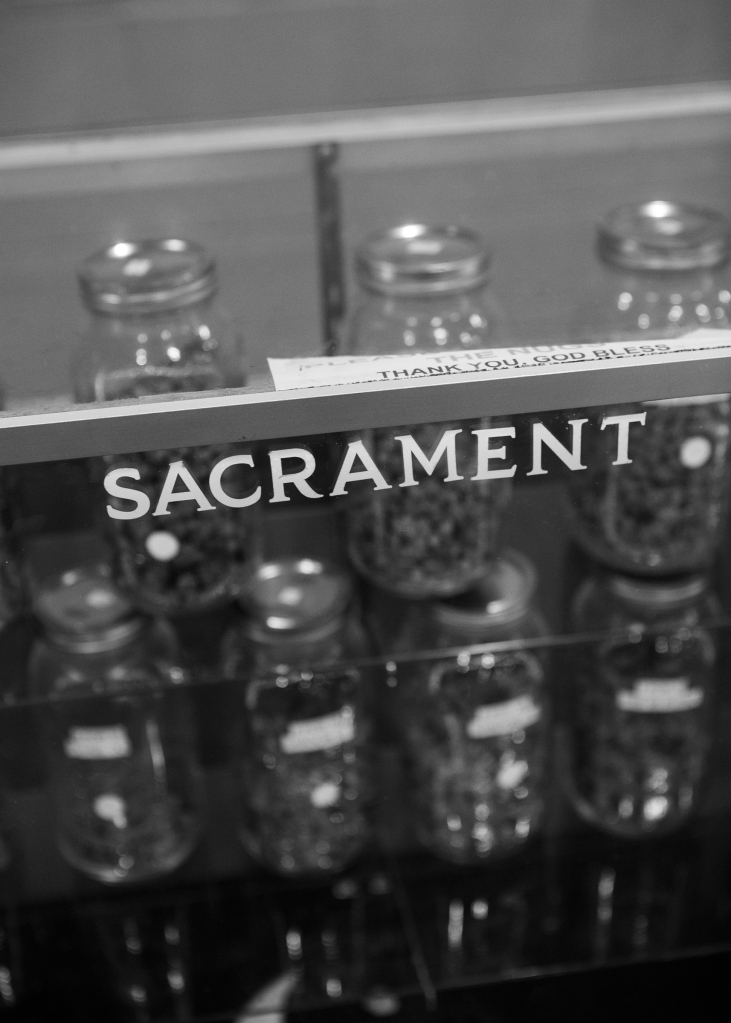 "A case containing jars of marijuana is labeled ""sacrament."" Photograph by Jessica Lehrman for RollingStone.com"