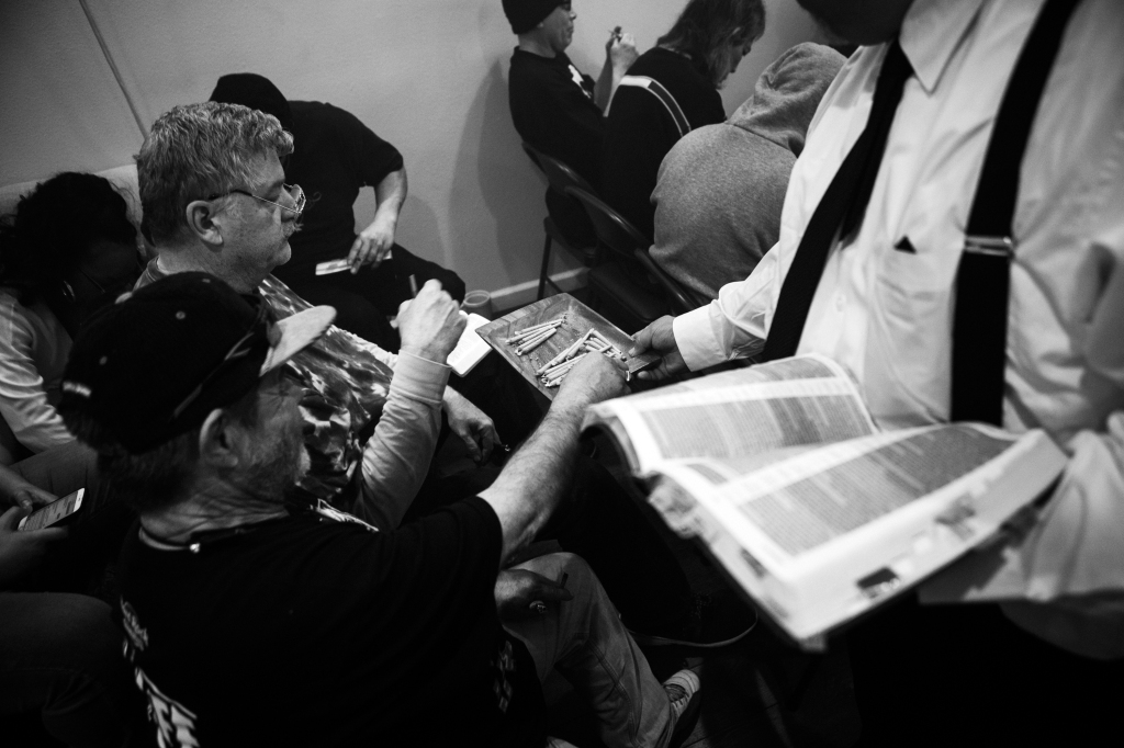 "The ""sacrament"" is distributed during a Sunday morning service at the Hundred Harmonies Church. Photograph by"