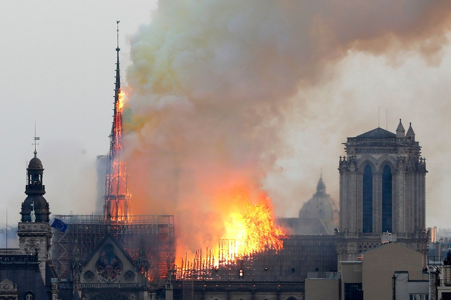 Flames rise from Notre Dame cathedral as it burns in Paris, . Massive plumes of yellow brown smoke is filling the air above Notre Dame Cathedral and ash is falling on tourists and others around the island that marks the center of ParisNotre Dame Fire, Paris, France - 15 Apr 2019
