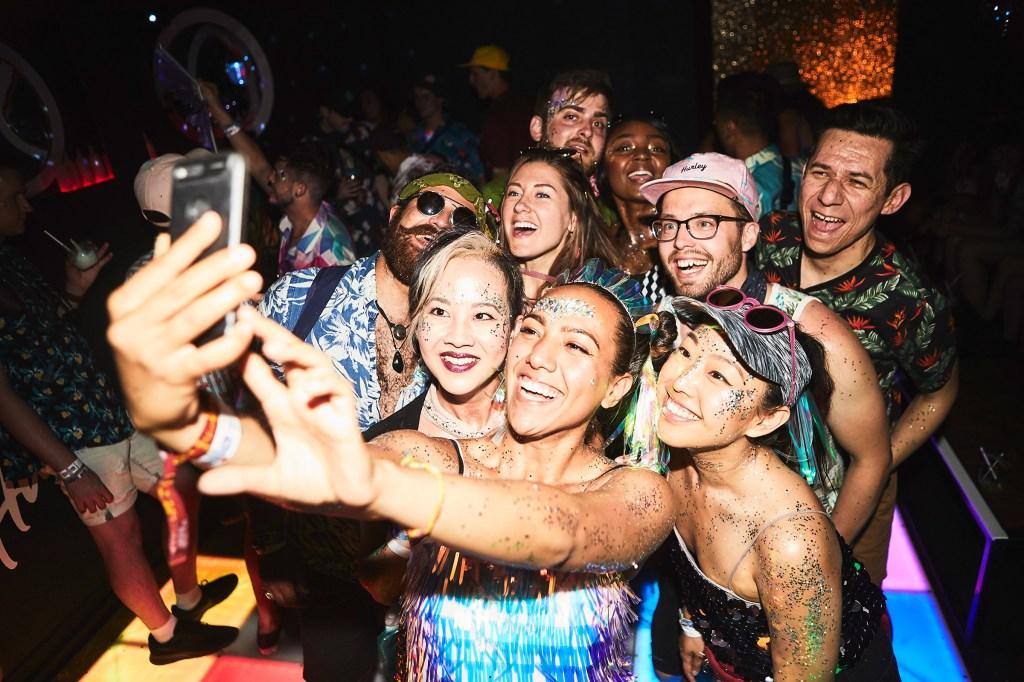 "Festivalgoers take a selfie in Hush Hush, a hidden ""speakeasy"" at Coachella"