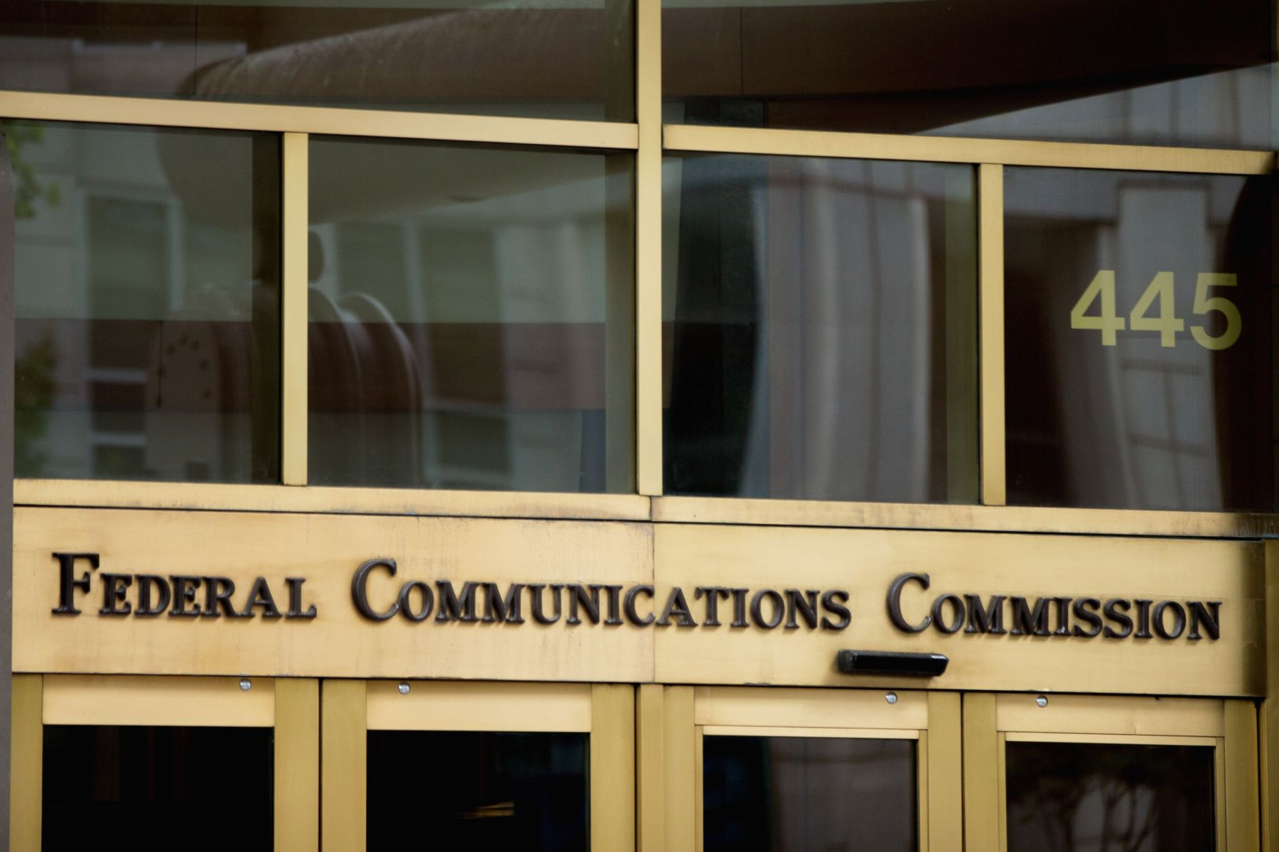 """The entrance to the Federal Communications Commission (FCC) building in Washington. The government's latest push to make sure consumers get equal access to the Internet faced a key legal test Friday as a federal appeals court considered whether to treat high-speed service providers as though they are public utilities. But two judges hearing more than three hours of technical arguments in the case seemed at times sympathetic to government attorneys arguing that the FCC was within its authority when it approved """"net neutrality"""" rules in FebruaryNet Neutrality, Washington, USA"""
