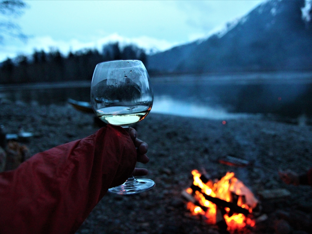 Just a glass of wine by the river at sunset, after a kayak ride, in northern BC, Canada.; Shutterstock ID 1314655187; Purchase Order: rs.com