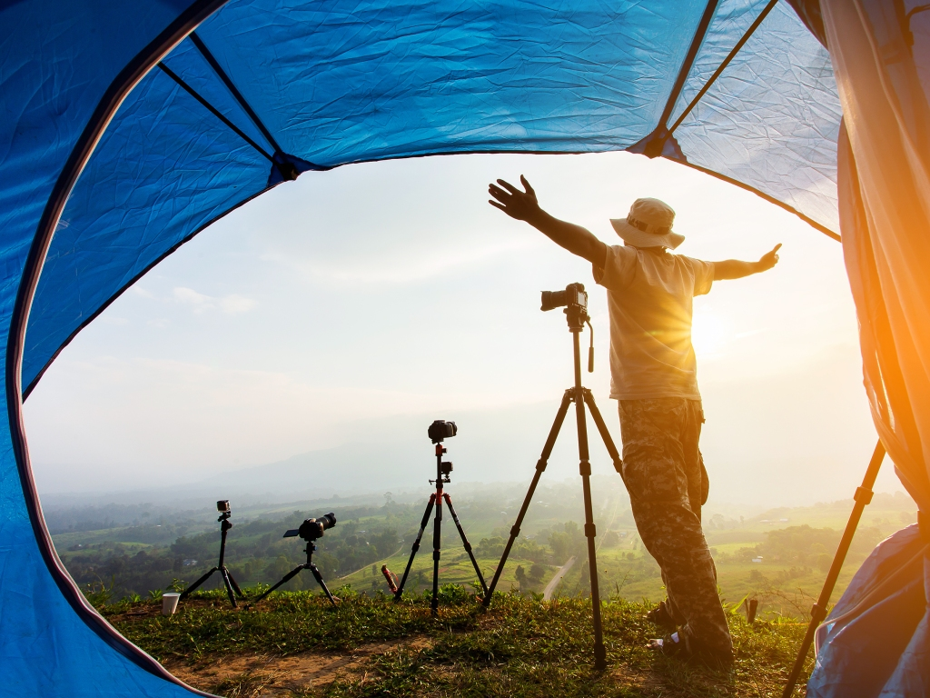 Camping tent in campground at the mountain with sunset,Sunset inside; Shutterstock ID 1204067032; Purchase Order: rs.com
