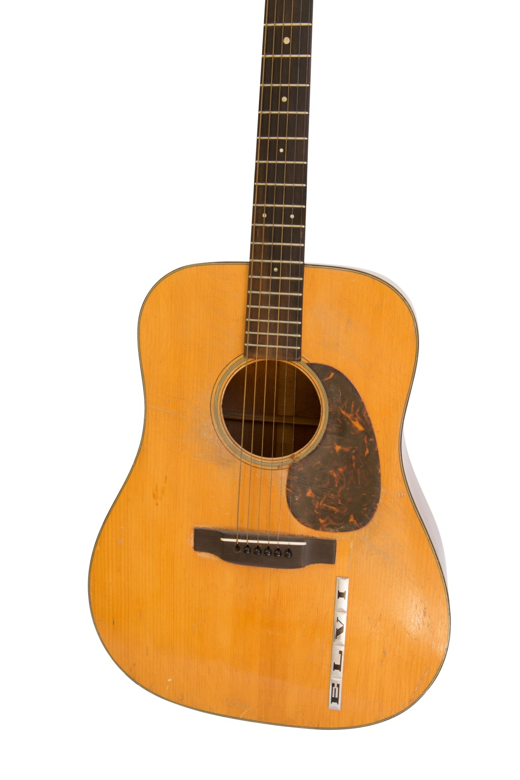 """Built in 1942, this Martin D-18 was used by Elvis Presley when he cut his first records for Sam Phillips and Sun Records in 1955. To make sure everyone knew who owned it, Presley used stick-on lettering, although the """"S"""" has since fallen off."""