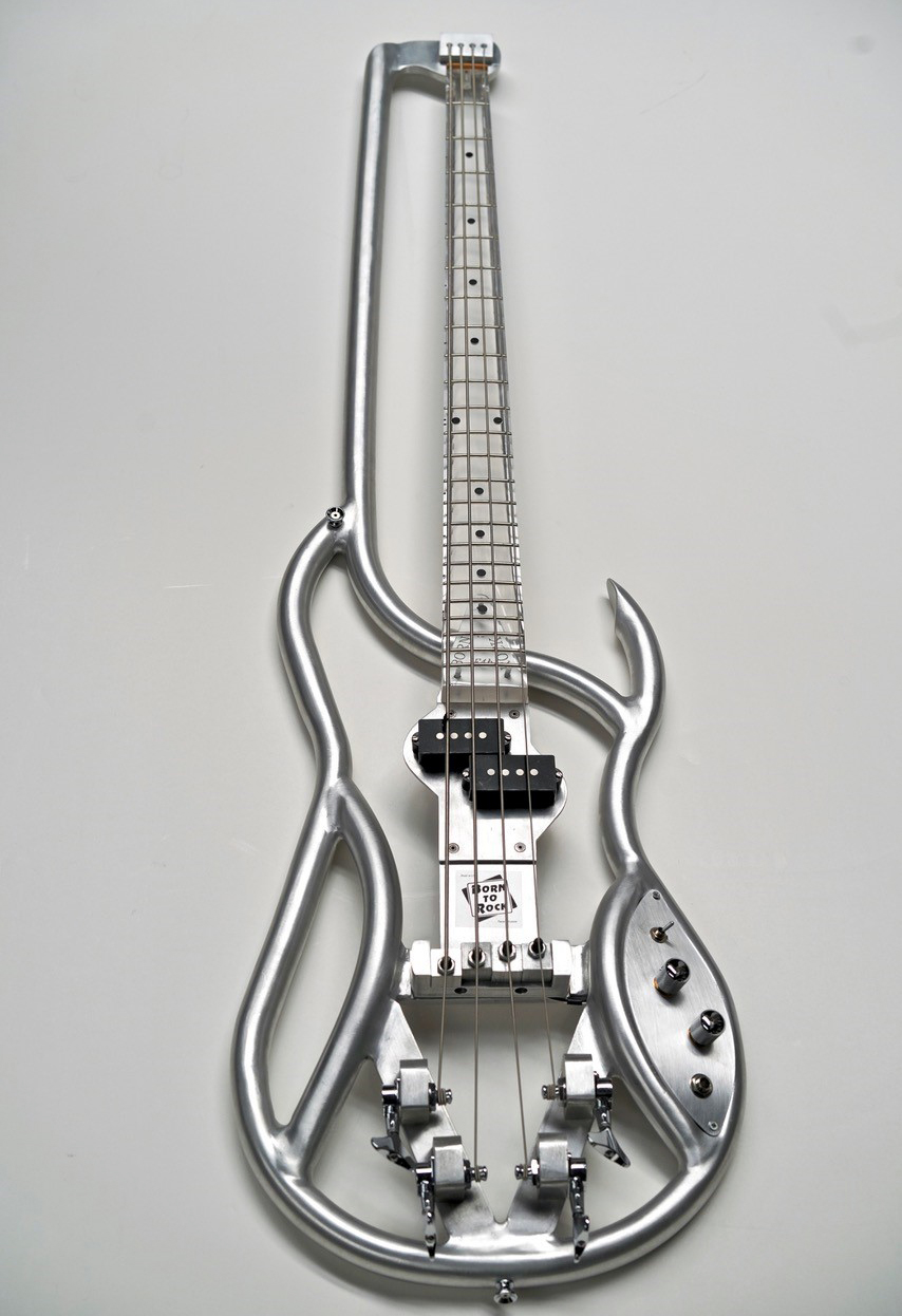 """A dedicated collector and lover of instruments, Steve Miller conceived of a lightweight aluminum tube frame bass that would """"avoid the warping associated with wooden instruments,"""" according to the museum. The result was this F4B instrument from 1995. Notice the absence of a peghead."""