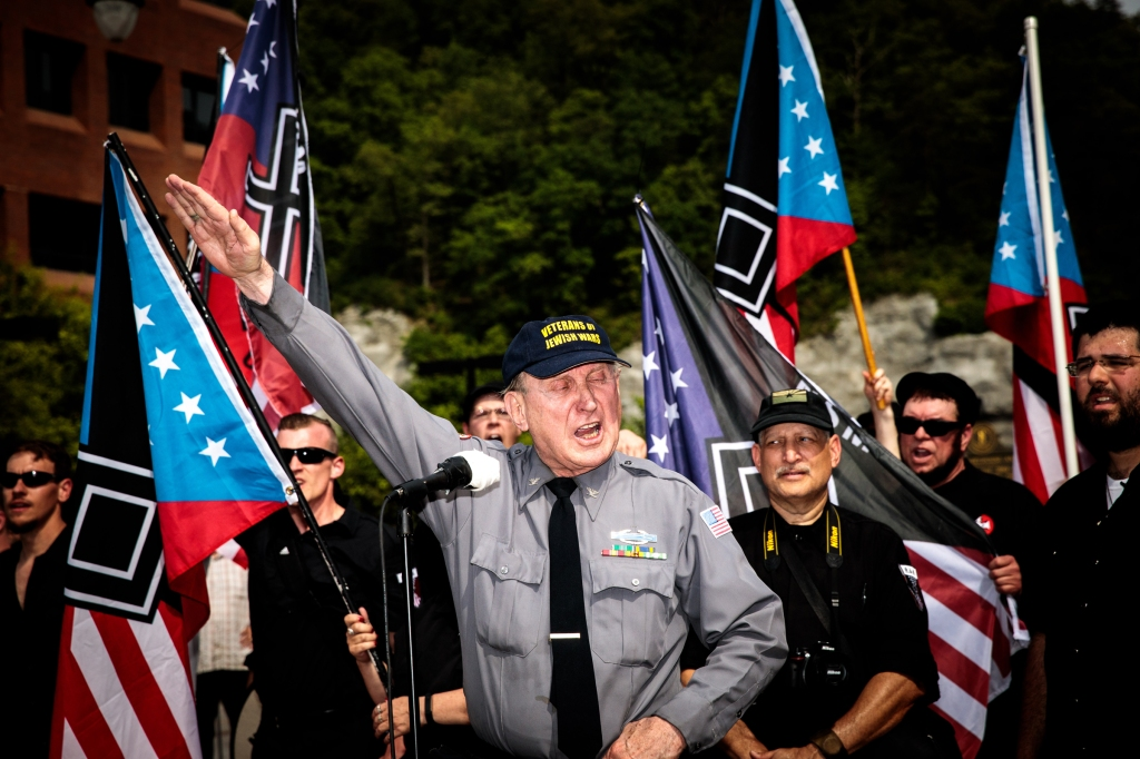 Art Jones gives the Nazi salute to conclude his speech at the rally. Photo credit: Tod Seelie