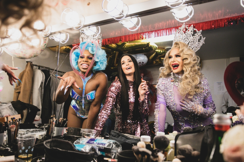 """While performing at the Ace Theater in L.A. in February, Kacey Musgraves invited newly crowned winners Monét X Change and Trinity the Tuck to join her onstage for her disco-country hit """"High Horse."""" """"So if you're here tonight it means that you're missing out on the finale of All Stars Season 4,"""" Musgraves told the audience. """"Tonight we have not one but two winning queens!"""" The trio danced to the chorus as screams and cheers came from the theater. """"The crowd lost their minds when the two queens came out,"""" Musgraves recalled. """"All that was missing was a death drop!"""""""
