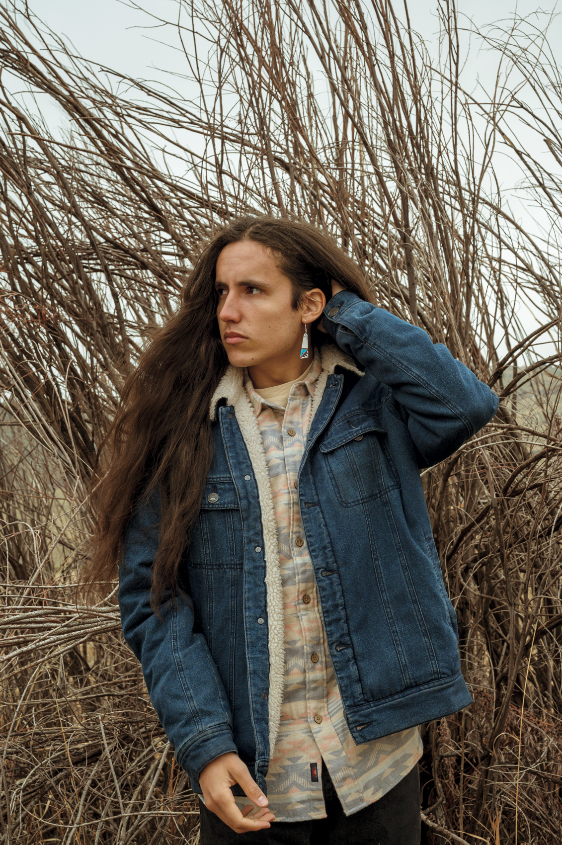 Xiuhtezcatl Martinez (pronounced: Shoe-Tez-Caht), 18, of Boulder, Colo., sits for a portrait in Boulder on Friday, March 29, 2019. Martinez is an indigenous environmental activist, musician, and youth director of Earth Guardians.
