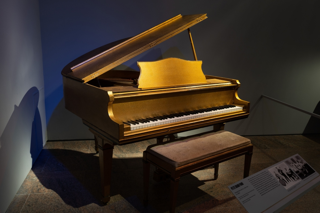 Onstage, Jerry Lee Lewis was a legendary wildman who would sometimes jump atop his piano. At home, though, Lewis preferred a more delicate model. This gold-painted keyboard, built in 1955, was Lewis' home piano between 1957 and 2017.