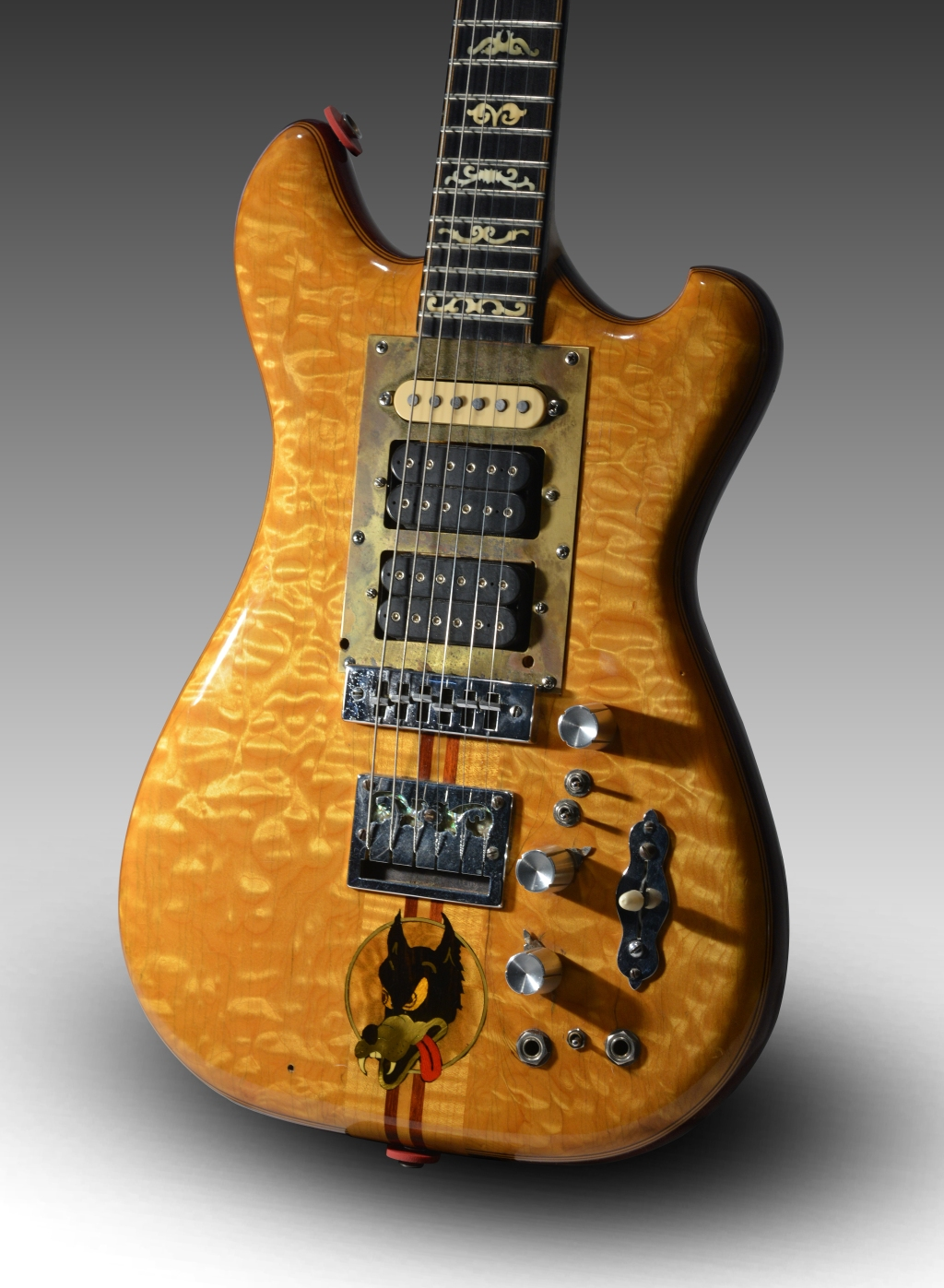 """Eager to take his guitar into the outer limits, Jerry Garcia had luthier Doug Irwin build this """"Wolf"""" guitar for him in 1972. Made of quilted and flamed maple, among other elements, it became Garcia's principal guitar between 1973 and 1979. Wolf was the first Garcia guitar that allowed him to experiment with MIDI (Musical Instrument Digital Interface), allowing him to make his guitar sound like other instruments."""