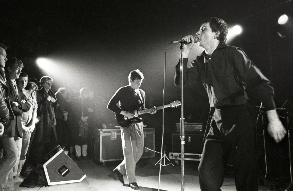 NETHERLANDS - JANUARY 16: ROTTERDAM Photo of Joy Division performing live in Rotterdam, Bernard Sumner (left) & Ian Curtis (Photo by Rob Verhorst/Redferns)