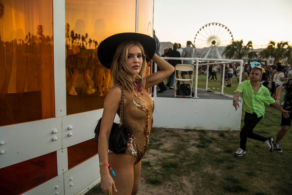 A festival goer poses with some onsite art on April 12, 2019.