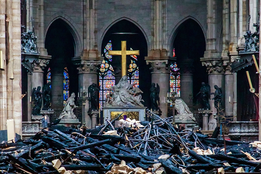 A view of the cross and the sculpture 'Pieta' by Nicholas Coustou behind debris inside the Notre-Dame de Paris in the aftermath of a fire that devastated the cathedral, in Paris, France, 16 April 2019. The fire started in the late afternoon on 15 April in one of the most visited monuments of the French capital.Cathedral of Notre-Dame of Paris fire aftermath, France - 16 Apr 2019