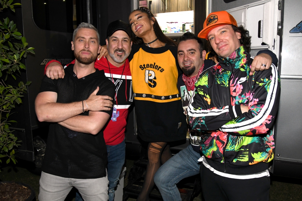 INDIO, CALIFORNIA - APRIL 14: Ariana Grande (C) with members of NSYNC Lance Bass, Joey Fatone, Chris Kirkpatrick and JC Chasez attend 2019 Coachella Valley Music And Arts Festival on April 14, 2019 in Indio, California. (Photo by Kevin Mazur/Getty Images for AG)