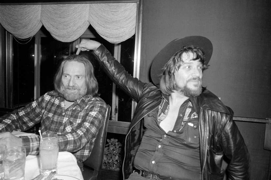 "(Original Caption) New York: Country-western singer stars Willie Nelson (left) and Waylon Jennings celebrate at a party at the Rainbow Room in honor of their new album, ""Waylon and Willie."""