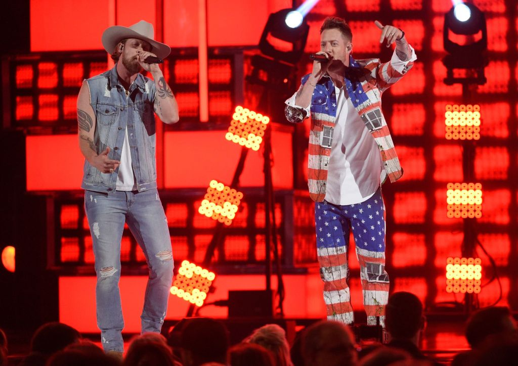 "Tyler Hubbard, Brian Kelley. Brian Kelley, left, and Tyler Hubbard, of Florida Georgia Line, perform ""Can't Hide Red"" at the 54th annual Academy of Country Music Awards at the MGM Grand Garden Arena, in Las Vegas54th Annual Academy of Country Music Awards - Show, Las Vegas, USA - 07 Apr 2019"