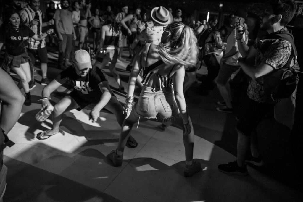 Fans dance during Tomasa del Real at Coachella on April 12, 2019.