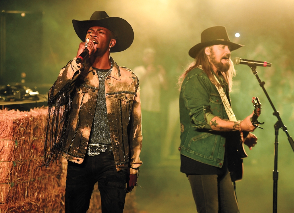 INDIO, CALIFORNIA - APRIL 28: Lil Nas X and Billy Ray Cyrus perform onstage during the 2019 Stagecoach Festival at Empire Polo Field on April 28, 2019 in Indio, California. (Photo by Frazer Harrison/Getty Images for Stagecoach)