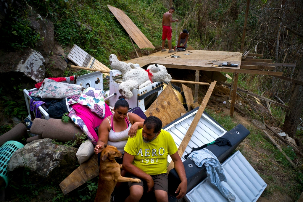 "Yadira Sortre and William Fontan Quintero pose to what is left of their belongings, destroyed by Hurricane Maria while their children build a room to protect themselves from the elements, in the San Lazaro neighborhood of Moravis, Puerto Rico, . ""We lost everything,"" Fontan said. They have three children, one lives in Chicago and two live with them in Puerto RicoPuerto Rico Hurricane Maria Victims - 30 Sep 2017"