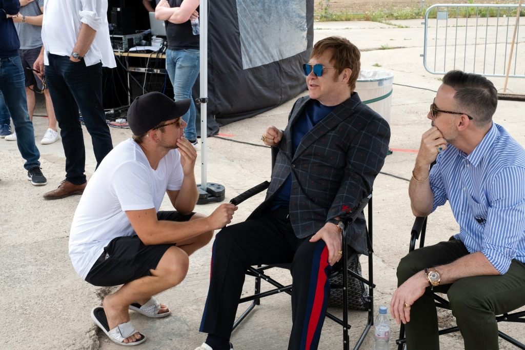 Taron Egerton, Elton John and David Furnish on the set of Rocketman from Paramount Pictures.
