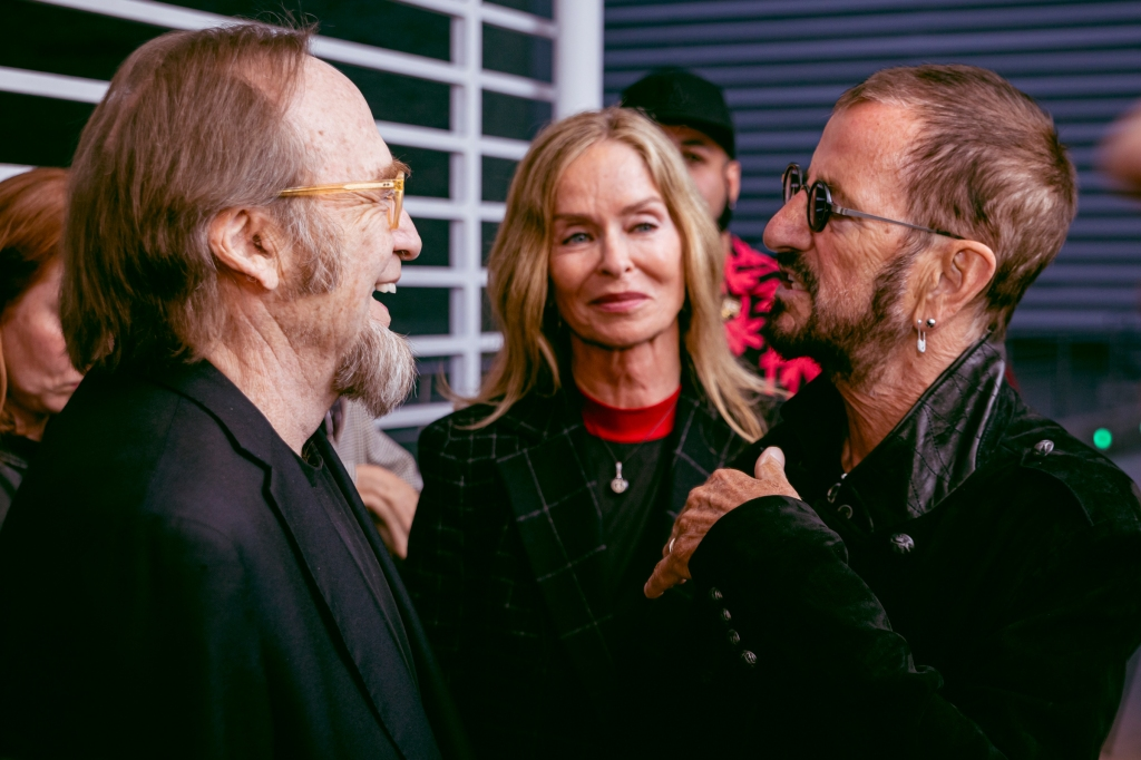 "Photos from the ""Echo In the Canyon"" premiere taking place in Los Angeles, California. Photographed on 5.23.19 at the Arclight Cinema. Talent (left to right): Stephen Stills, Barbara Bach & Ringo Starr."