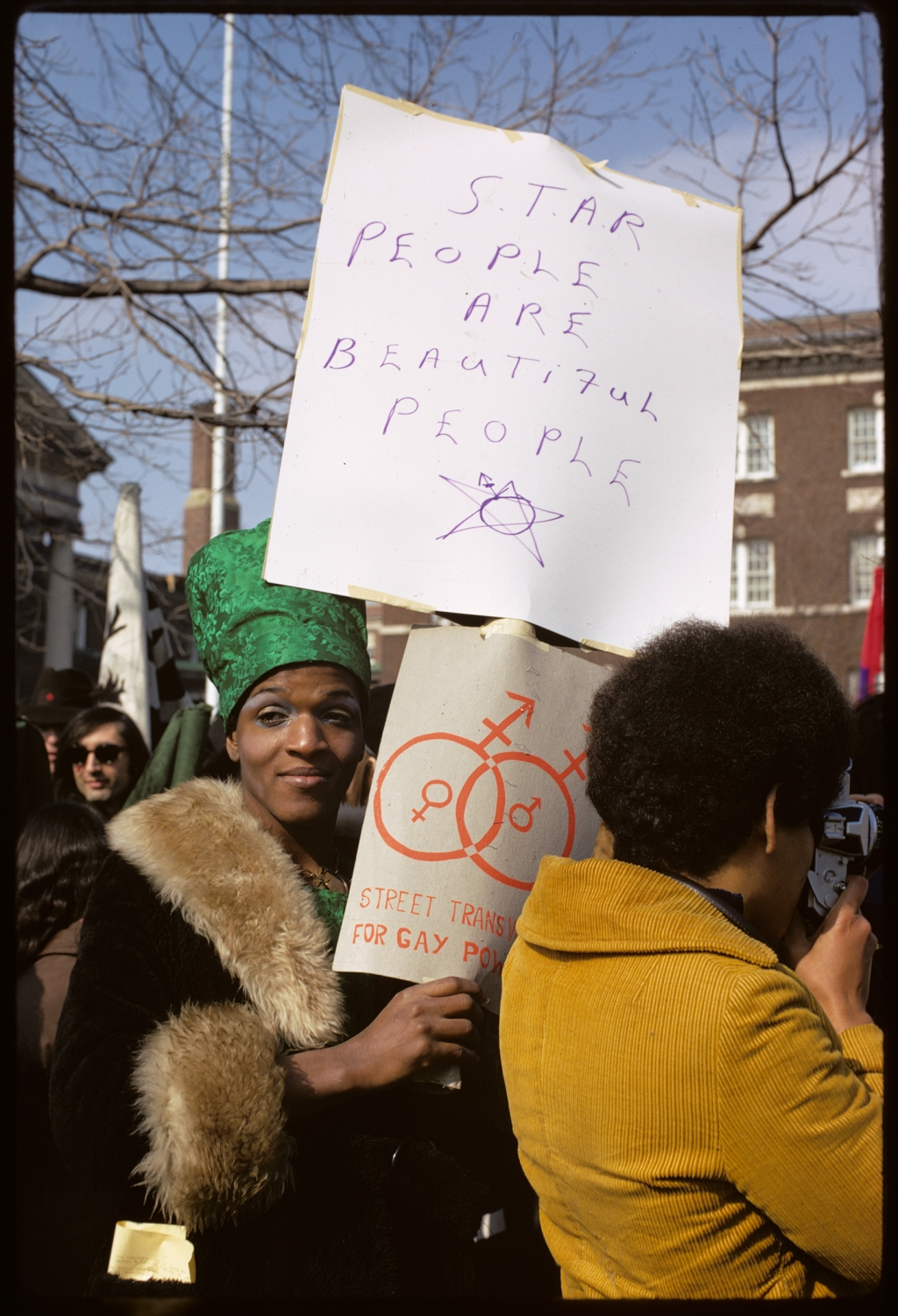 """""""I didn't get downtown until about two o'clock,"""" said Marsha P. Johnson, one of the most renowned activists of the Stonewall Riots, in an interview with journlist Eric Marcus. """"When I got downtown, the place was already on fire."""" But clashing with the police was commonplace for her by 1969. """"I'd been going to jail for like, 10 years before the Stonewall."""" At the time, you had to have at least three articles of clothing that matched your legal gender, or you could be arrested for masquerading (Miss Major, a leader in the trans-rights community who was also at the riots, would wear a men's watch, briefs and a t-shirt rolled up under her skirt.) Dressing in gender non-conforming clothing was one of the easiest ways to be targeted by the police, which is why drag queens and butch lesbians were the primary for arrest by the police during the Stonewall riots."""