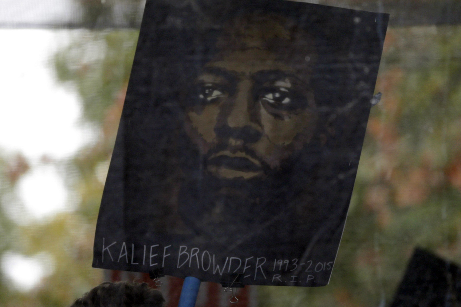 A Protester Holds a Picture Kalief Browder who Committed Suicide After Spending Three Years at Rikers Island Prison As a Teenager Attends a Rally Before Participating in a Protest March Calling For 'Stop Police Terror and Murder' in New York New York Usa 24 October 2015 United States New YorkUsa Protest March Police - Oct 2015