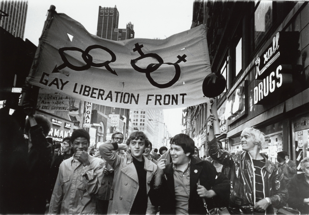 """The Gay Liberation Front was born of the Stonewall Riots. Through the 1950s and 1960s, the Mattachine Society was the dominant gay civil rights group. But the uprising galvanized a new generation of LGBTQ people. """"It was 1969 and Mattachine had become old,"""" wrote activist and journalist Mark Segal. """"They were men in suits. We were men in jeans and t-shirts."""" They first joined the Mattachine Society's Action Group, but as a generation forged in the anti-Vietnam War efforts, they were quickly turned off by their conservative dress and focus on military enlistment. The Gay Liberation Front strove to be intersectional: they demonstrated against employment discrimination and the anti-trans masquerading laws, while maintaining an anti-war, anti-racist, anti-colonialist platform. """"The Gay Liberation Front has mostly been ignored in the history books,"""" wrote Segal, """"even though it helped forge the foundation upon which our community is built."""""""