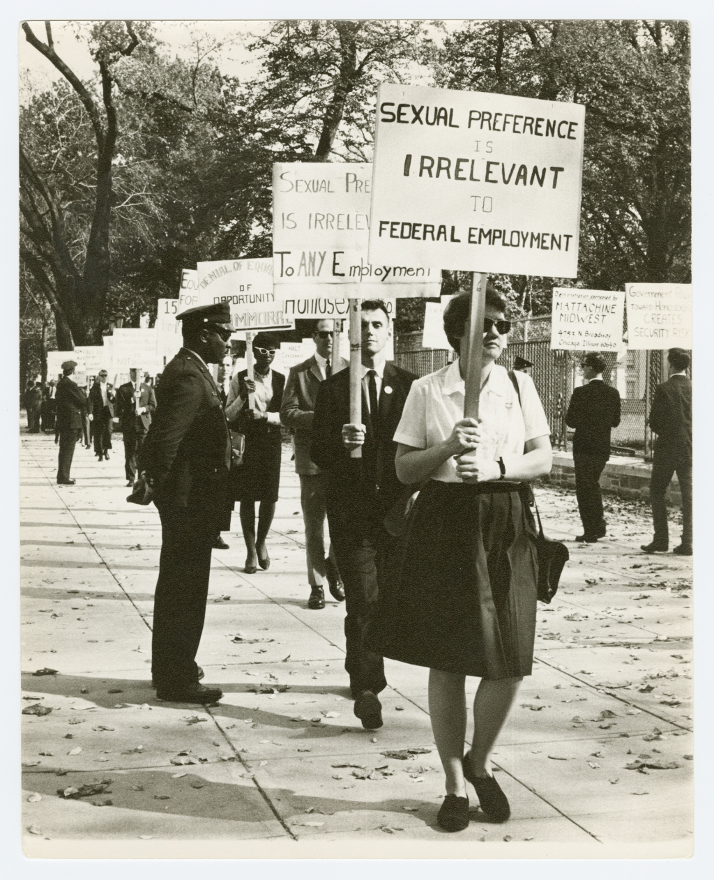 """Pre-Stonewall, gay civil rights demonstrations generally centered around military employment discrimination, because the government avoided hiring LGBTQ people due to """"the Pink Scare."""" """"In the 1950s and 60s, fears about homosexuals — particularly in employment — is that we were blackmailable,"""" says Bauman. Because we have a secret, the communists could get us to share government secrets."""" Nearly all of the photographs from these early gay-rights protests were taken by Kay Tobin Lahusen, the first out gay photojournalist in the United States. """"Kay was able to frame these as historic photographs,"""" says Baumann, """"But there's less than 20 people here. This is everybody who was willing to put their butts on the line on the East Coast for gay rights. It looks like a historic event, and it is! But it's a small group of people."""""""