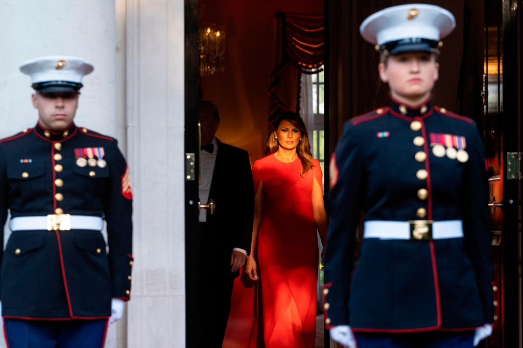 Trump and Melania's formal wear was on full display throughout the trip. Here, they arrive to greetPrince Charles and his wife Camilla ahead of a dinner at Winfield House.